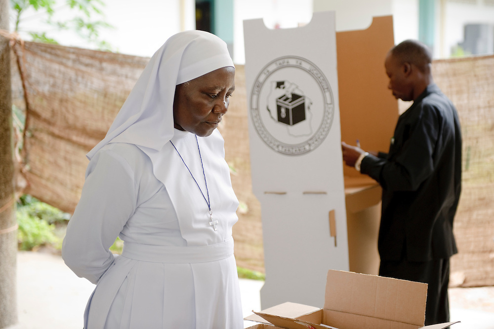 Dar Es Salaam, Tanzania 31 October 2010<br /> A Tanzanian religious is listening to a polling station officer who is explaining in which box she should drop her vote.<br /> The European Union has launched an Election Observation Mission in Tanzania to monitor the general elections, responding to the Tanzanian government invitation to send observers for all aspects of the electoral process.<br /> The EU sent this observation mission led by Chief Observer David Martin, a member of the European Parliament. <br /> PHOTO: EZEQUIEL SCAGNETTI