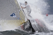 Alinghi bowman Dean Phipps gets a dousing on the foredeck during the pre-start for their last semifinal match against Oracle. 16/12/2002 (© Chris Cameron 2002)