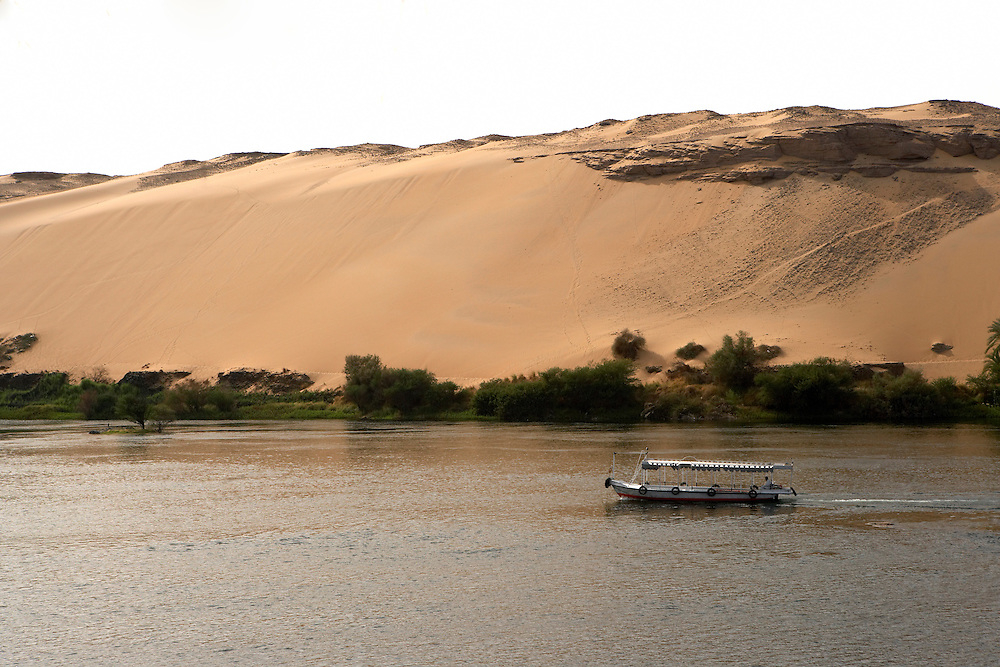 Tourboat and sand dune on the Nile River  Aswan, Egypt