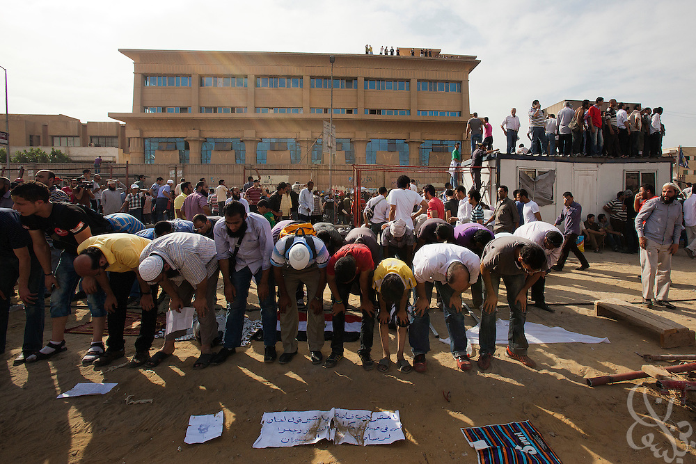 A mix of Salafi and revolutionary youth activists take time out of their battle with Egyptian security forces to pray during May 4, 2012 demonstrations against the ruling Supreme Council of the Armed Forces (SCAF) near the Defense ministry building in the Abbasiya district of Cairo. Close to 300 people were injured in the clashes, one killed, and an estimated 300 people arrested by the military.