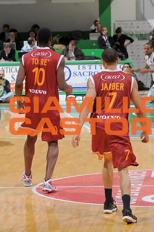 DESCRIZIONE : Siena Lega A 2009-10 Montepaschi Siena Lottomatica Virtus Roma<br /> GIOCATORE : Ibrahim Jaaber Herve Toure<br /> SQUADRA : Lottomatica Virtus Roma<br /> EVENTO : Campionato Lega A 2009-2010<br /> GARA : Montepaschi Siena Lottomatica Virtus Roma<br /> DATA : 22/11/2009<br /> CATEGORIA : Sponsor<br /> SPORT : Pallacanestro<br /> AUTORE : Agenzia Ciamillo-Castoria/G.Vannicelli<br /> Galleria : Lega Basket A 2009-2010<br /> Fotonotizia : Siena Campionato Italiano Lega A 2009-2010 Montepaschi Siena Lottomatica Virtus Roma<br /> Predefinita :