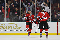 Feb 9; Newark, NJ, USA; New Jersey Devils left wing Zach Parise (9) celebrates his power play goal during the first period at the Prudential Center.