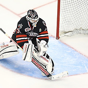 Clay Witt #31 of the Northeastern Huskies stops a shot during The Beanpot Championship Game at TD Garden on February 10, 2014 in Boston, Massachusetts. (Photo by Elan Kawesch)
