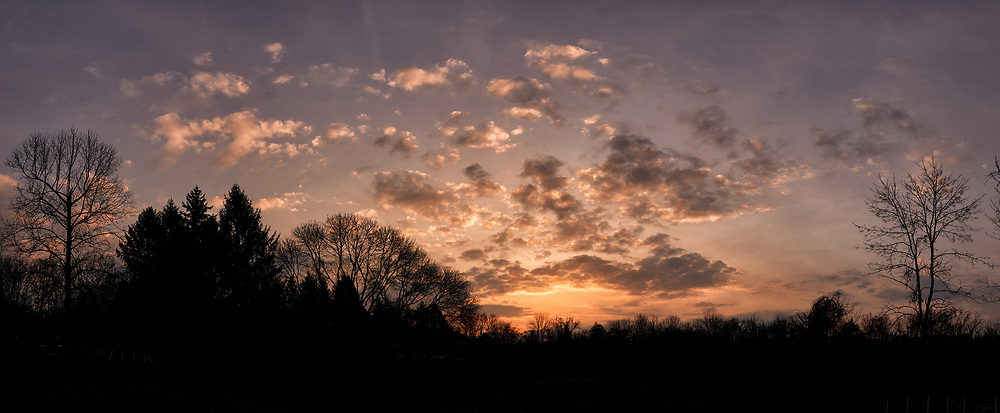 Springtime Dawn Panorama; Silhouettes, Colorful Clouds and Sky. Composite of eighteen images taken with a Leica CL camera and 18 mm f/2.8 lens (ISO 100, 18 mm, f/10, 1/30 sec). Raw images processed with Capture One Pro and AutoPano Giga Pro.