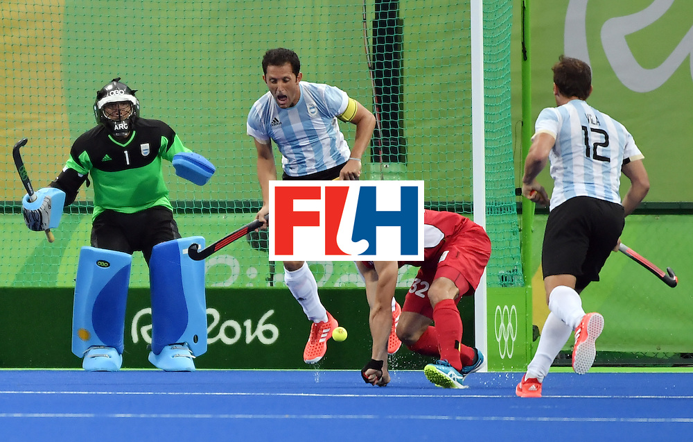 Belgium's Tanguy Cosyns (2nd R) scores a goal during the men's Gold medal field hockey Belgium vs Argentina match of the Rio 2016 Olympics Games at the Olympic Hockey Centre in Rio de Janeiro on August 18, 2016. / AFP / Pascal GUYOT        (Photo credit should read PASCAL GUYOT/AFP/Getty Images)