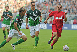 28.08.2010, Weserstadion, Bremen, GER, 1. FBL, Werder Bremen vs 1. FC Köln / Koeln, im Bild Clemens Fritz (Bremen #8, links), Marko Arnautovic (Bremen #7, Mitte), Lukas Podolski (Koeln #10, rechts)   EXPA Pictures © 2010, PhotoCredit: EXPA/ nph/  Frisch+++++ ATTENTION - OUT OF GER +++++