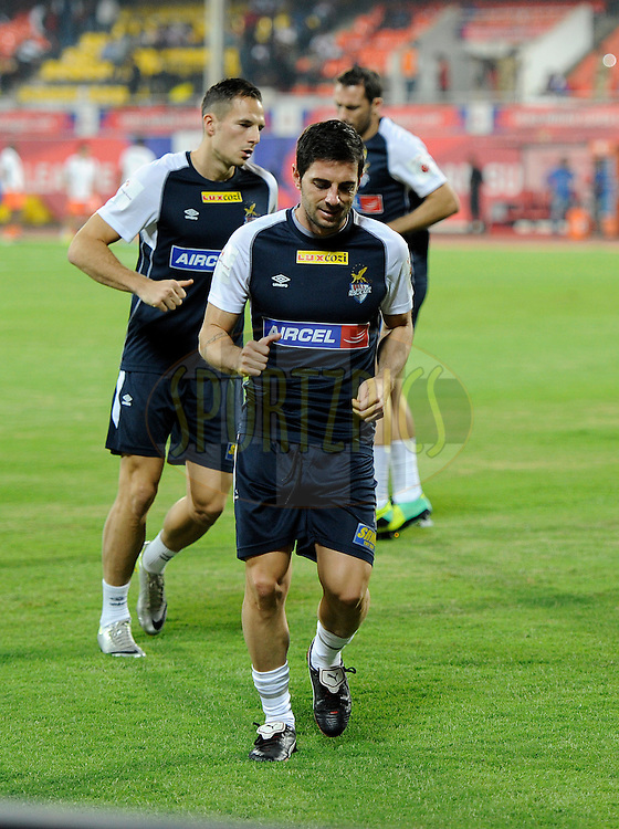 Players from Atletico de Kolkata during a warm up session before the start of the match 44 of the Hero Indian Super League between FC Pune City and Atletico de Kolkata FC held at the Shree Shiv Chhatrapati Sports Complex Stadium, Pune, India on the 29th November 2014.<br /> <br /> Photo by:  Pal Pillai/ ISL/ SPORTZPICS