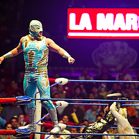 Men in costumes, fake wrestling.  WWE Mexican style.  Mexico City, Mexico