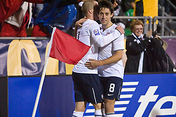 United States midfielder Michael Bradley (4) celebrates his second goal of the game in the 92nd minute with United States forward Clint Dempsey (8).  The United States men's soccer team defeated the Mexican national team 2-0 in CONCACAF final group qualifying for the 2010 World Cup at Columbus Crew Stadium in Columbus, Ohio on February 11, 2009.