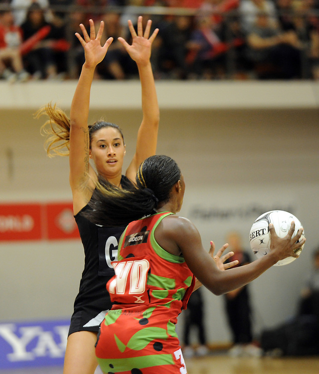 New Zealands' Maria Tutaia defends against Malawis' Melenia Gideon in the International Netball test at Pettigrew Green Arena, Napier, New Zealand, Sunday, October 27, 2013. Credit:SNPA / Ross Setford