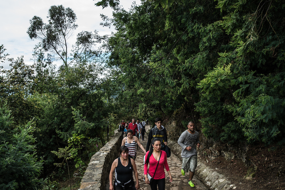 BOGOTA, COLOMBIA - OCTOBER 25, 2015: If you have energy, join the crowds of locals hiking up Monserrate, a 10,000 foot high mountain that overlooks the city and is home to a 17th century statue of the Fallen Christ, housed in a church that draws the devout. It's considered important to make the steep trek on foot if you're going for religious reasons, but there is also an efficient funicular and cable cars that cycle up and down the mountain regularly and which are much more comfortable. The views from the top, which encompass the entire sweep of the city as it stretches out westwards from the mountain, are spectacular.  PHOTO: Meridith Kohut for The New York Times