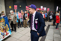 © Licensed to London News Pictures . 29/09/2017 . Torquay , UK . A UKIP supporter videos protesters including one carrying a banner featuring Nigel Farage as Adolf Hitler , outside the venue . The UK Independence Party Conference at the Riviera International Centre . UKIP is due to announce the winner of a leadership election which has the potential to split the party . Photo credit: Joel Goodman/LNP