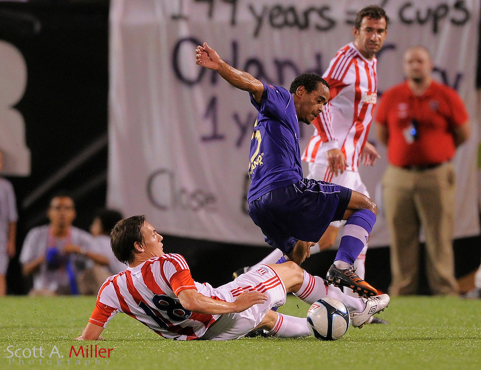 Stoke City Potters midfielder Dean Whitehead (18) tackles Orlando City Lions forward George Davis IV (25) at the Florida Citrus Bowl on July 28, 2012 in Orlando, Florida. Stoke won 1-0...© 2012 Scott A. Miller.