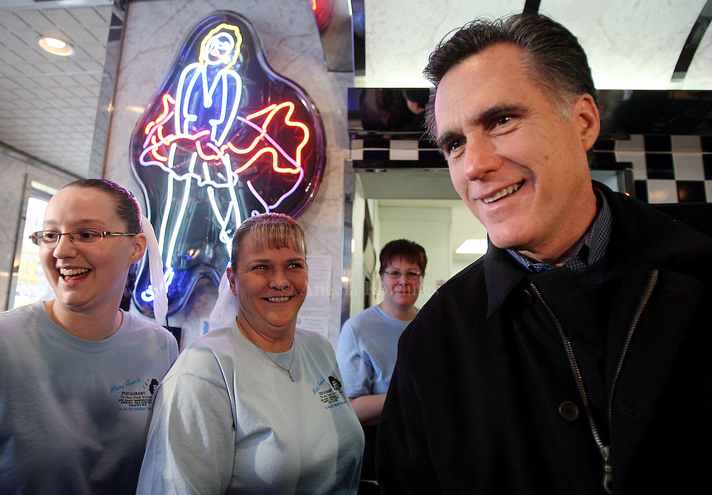 (010708  Derry, NH) Republican presidential candidate Mitt Romney laughs with waitresses Jami Playdon, left, Nancy Harper and Jackie Stilley as he campaigns at Mary Ann's Diner, Monday,  January 07, 2008.  Staff photo by Angela Rowlings.