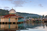 Mosque in a water village, Manokwari, West Papua, Indonesia. Manokwari is a small town on the north east coast of the Bird's Head Peninsula, West Papua, Indonesia.  Its harbour has many wrecks from WWII.