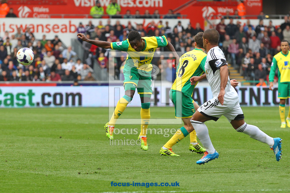 Alexander Tettey of Norwich heads for goal during the Barclays Premier League match at the Liberty Stadium, Swansea<br /> Picture by Paul Chesterton/Focus Images Ltd +44 7904 640267<br /> 29/03/2014