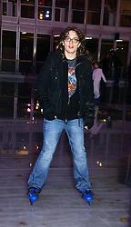 Rock vocalist and guitarist JUSTIN HAWKINS from The Darkness at the opening of the Natural History Museum's ice rink, Cromwell Road, London on 14th November 2006.<br />