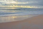 Peaceful beach blue sky and clouds, Palm Coast, Florida, USA at sunrise.