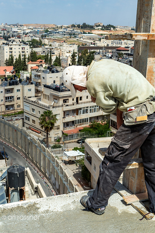 Portrait of a Palestinian working in the construction of a building on the Israeli side of the Palestinian neighbourhood of Dahiyat al-Bareed.  This Palestinian neighbourhood part of the A-ram village is situated North of Jerusalem neer Givat Yaakov setlement. The barrier was constructed in 2006 and forced palestinians holding Israeli ID to move to the Israeli side, otherwise their Israeli ID would be taken away.