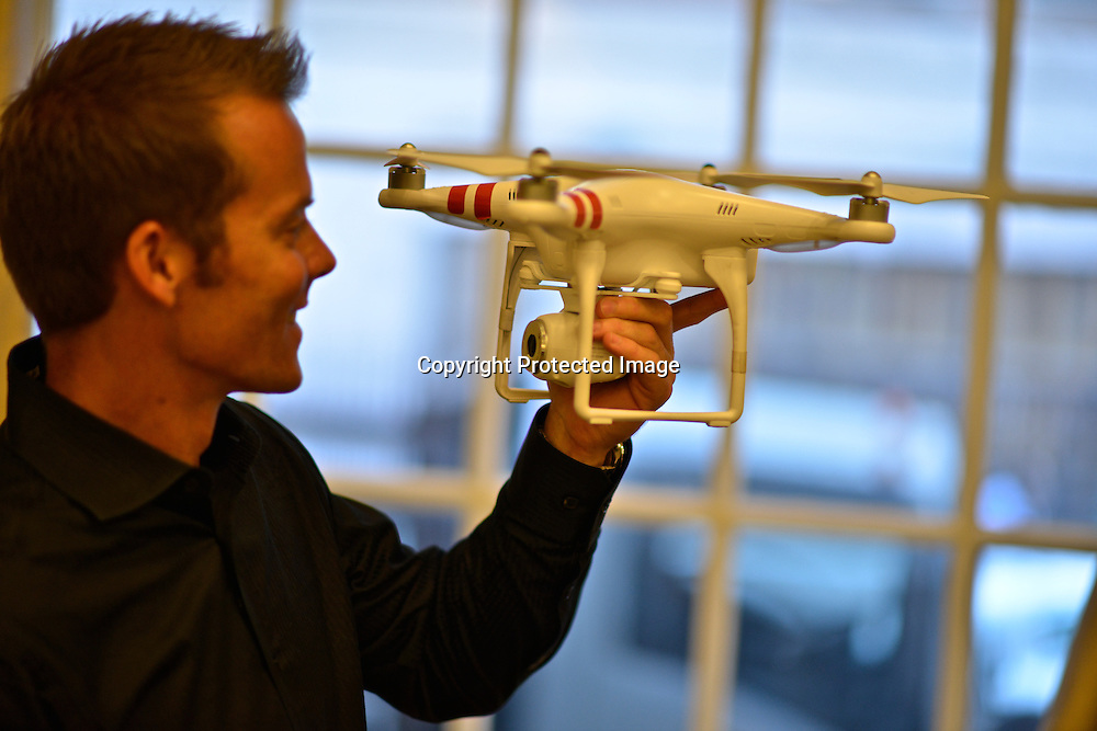Portrait of Colin Guinn, CEO of DJI Innovations with one of his creations, the Phantom Drone. Guinn  with has more than 15 years in aerial photography and component design.