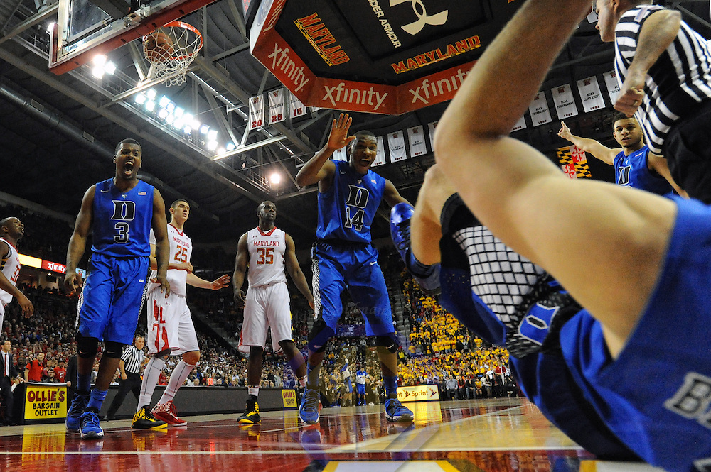 16 February 2013:   Duke Blue Devils guard Tyler Thornton (3) and guard Rasheed Sulaimon (14) move to help forward Mason Plumlee (5) up after he was fouled in action against the Maryland Terrapins at the Comcast Center in College Park, MD. where the Maryland Terrapins defeated the Duke Blue Devils, 83-81.