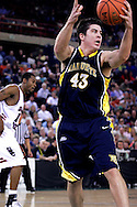 26 November 2005: MU's Ryan Amoroso (43) grabs a rebound in the Marquette Golden Eagle 92-89 overtime victory over the University of South Carolina Gamecocks to win the championship at the Great Alaska Shootout in Anchorage, Alaska..