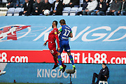 Nottingham Forest midfielder John Bostock (13) and Wigan Athletic midfielder Michael Jacobs (17) go for the high ball during the EFL Sky Bet Championship match between Wigan Athletic and Nottingham Forest at the DW Stadium, Wigan, England on 20 October 2019.