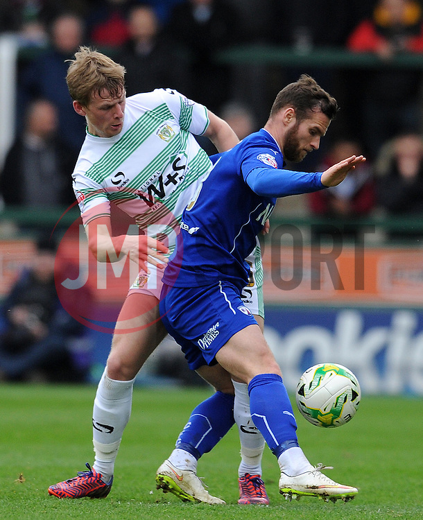 Chesterfield's Jimmy Ryan is tackled by Yeovil Town's Stephen Kingsley - Photo mandatory by-line: Harry Trump/JMP - Mobile: 07966 386802 - 03/04/15 - SPORT - FOOTBALL - Sky Bet League One - Yeovil Town v Chesterfield - Huish Park, Yeovil, England.