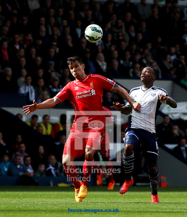 Saido Berahino (right) of West Bromwich Albion and Dejan Lovren (left) of Liverpool battle for the ball during the Barclays Premier League match at The Hawthorns, West Bromwich<br /> Picture by Tom Smith/Focus Images Ltd 07545141164<br /> 25/04/2015