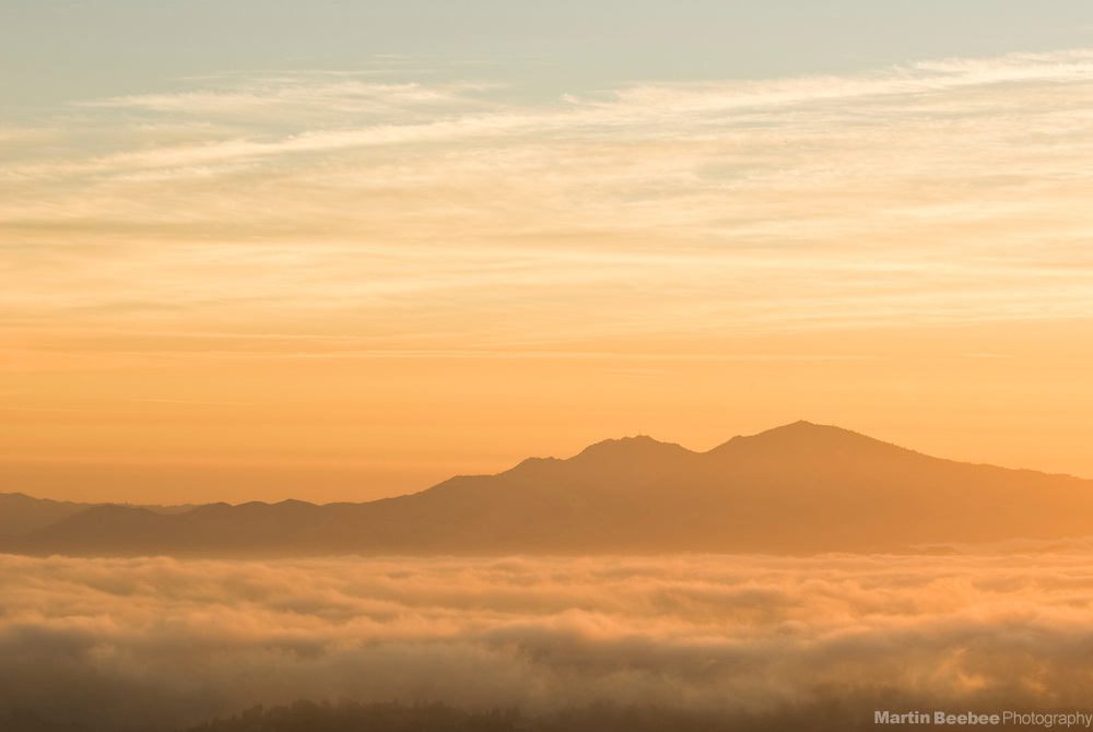 Mount Diablo rising above the fog at sunrise, California