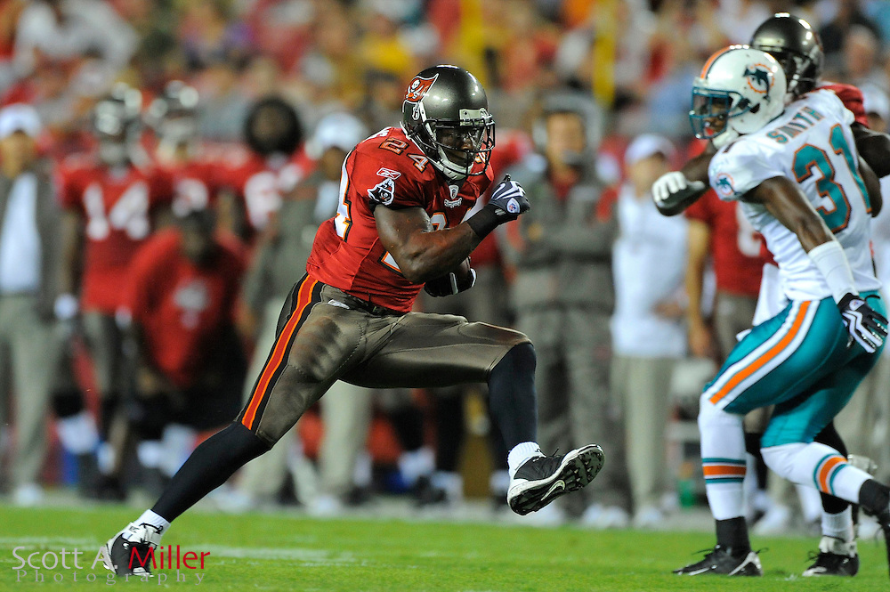 Aug. 27, 2009; Tampa, FL, USA; Tampa Bay Buccaneers running back Carnell Williams (24) heads up field during the first half of the Bucs game against the Miami Dolphins at Raymond James Stadium. Mandatory Credit: Scott A. Miller-US PRESSWIRE.© 2009 Scott A. Miller.© 2009 Scott A. Miller