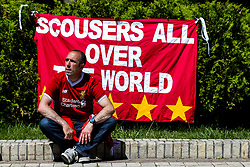 A Liverpool fan sits in front of a flag in the fan park ahead of the Champions League Final - Mandatory by-line: Robbie Stephenson/JMP - 26/05/2018 - FOOTBALL - Olympic Stadium - Kiev,  - Real Madrid v Liverpool - UEFA Champions League Final