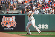 San Francisco Giants shortstop Brandon Crawford (35) throws a fielded ball to first base against the Philadelphia Phillies at AT&T Park in San Francisco, California, on August 20, 2017. (Stan Olszewski/Special to S.F. Examiner)