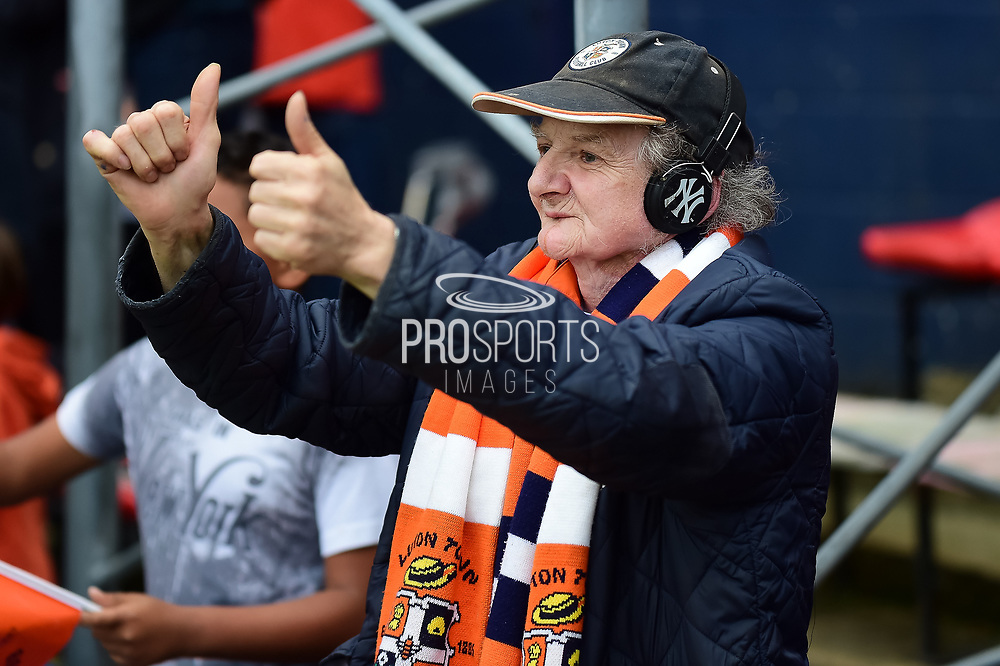 An elderly female fan in Luton colours gives her heroes  a thumbs up during the EFL Sky Bet League 2 match between Luton Town and Stevenage at Kenilworth Road, Luton, England on 14 October 2017. Photo by Dennis Goodwin.
