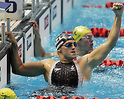 New Zealand's Moss Burmester celebrates after winning gold in the mens 200m butterfly final during the swimming at the Melbourne Sports & Aquatic Centre on day one of the XVIII Commonwealth Games, Melbourne, Australia, Thursday, March 16 2006. Photo: Michael Bradley/PHOTOSPORT<br /><br /><br /><br />149767