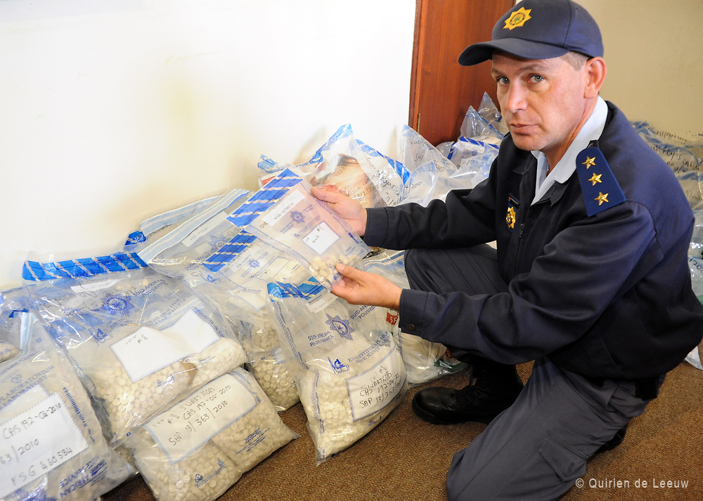 Police capt. Andre Beetge shows drugs-catch. Swartkop, South Africa.