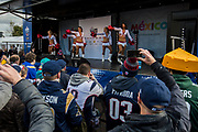 Fans watch the Arizona Cardinals Cheerleaders on stage in the tail gate during the International Series match between Arizona Cardinals and Los Angeles Rams at Twickenham, Richmond, United Kingdom on 22 October 2017. Photo by Jason Brown.