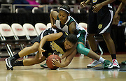 LaKendra Marsh (22) of Arkansas-Pine Bluff battles for a loose ball with Derita Silas (23) of Mississippi Valley State University during the SWAC semi-finals at the Curtis Culwell Center in Garland on Friday, March 15, 2013. (Cooper Neill/The Dallas Morning News)