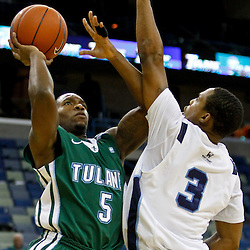 November 27, 2011; New Orleans, LA; Tulane Green Wave guard Jordan Callahan (5) shoots over San Diego Toreros guard Darian Norris (3) during the first half of Hoops for Hope Classic at the New Orleans Arena.  Mandatory Credit: Derick E. Hingle-US PRESSWIRE