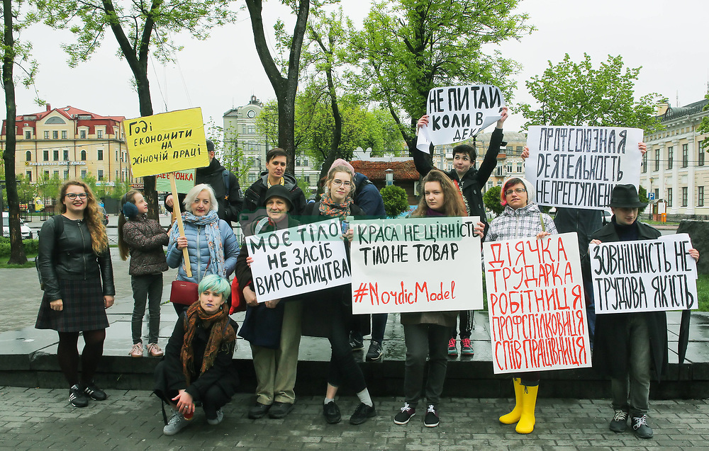 May 1, 2019 - Kiev, Ukraine - A few young people mark May Day standing with a placards which say ''Enough to save on women's labor'', ''Trade union activity is not a crime'', ''My body is not a means of production'', ''Don't ask me about maternity leave'' at Kontraktova square in Kyiv, Ukraine, May 1, 2019. (Credit Image: © Sergii Kharchenko/NurPhoto via ZUMA Press)