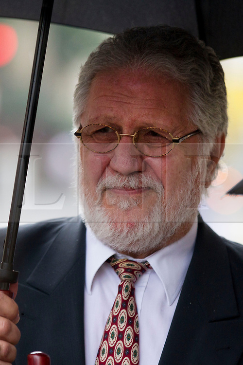 © Licensed to London News Pictures. 06/09/2013. London, UK. Former radio disc jokey Dave Lee Travis, real name David Patrick Griffin, arrives at the Old Bailey in London today (06/09/2013) ahead of his trial for sexual assault. Travis, who was arrested by the Metropolitan Police as part of the Operation Yewtree inquiry, is charged with with several counts of indecent or sexual assault dating back to the 1970's. Photo credit: Matt Cetti-Roberts/LNP