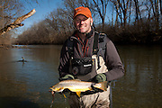 "Fly Fishing Guide Ron Lewis of Ohio Trophy Trout Hunter guide service holds a  Brown Trout, Salmo trutta, caught on a large ""Meal Ticket"" streamer tied by Mike Schmidt of Angler's Choice Flies. Mad River, western Ohio."