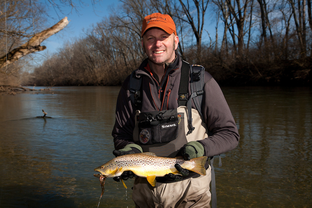 """Fly Fishing Guide Ron Lewis of Ohio Trophy Trout Hunter guide service holds a  Brown Trout, Salmo trutta, caught on a large """"Meal Ticket"""" streamer tied by Mike Schmidt of Angler's Choice Flies. Mad River, western Ohio."""