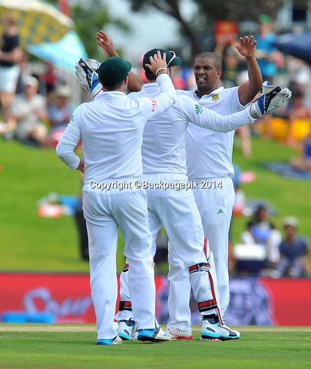 Vernon Philander of South Africa celebrates with teammates during the 2014 Sunfoil 1st Test match between South Africa and West Indies at the Supersport Park in Pretoria, South Africa on December 19, 2014 ©Samuel Shivambu/BackpagePix