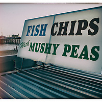 Fast food sign on Brighton sea front. East Sussex, England