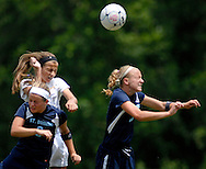 26 MAY 2012 -- TOWN & COUNTRY, Mo. -- Visitation Academy soccer player Natalie Breeden (12) battles St. Dominic High School players Katy Rood (3) and Molly Ream (10) during the MSHSAA Class 2 girls' soccer quarterfinals at Visitation Saturday, May 26, 2012. St. Dominic topped the Vivettes 8-1 to advance to Friday's semifinals against Helias Catholic High School at Blue Springs South High School.  Photo © copyright 2012 Sid Hastings.