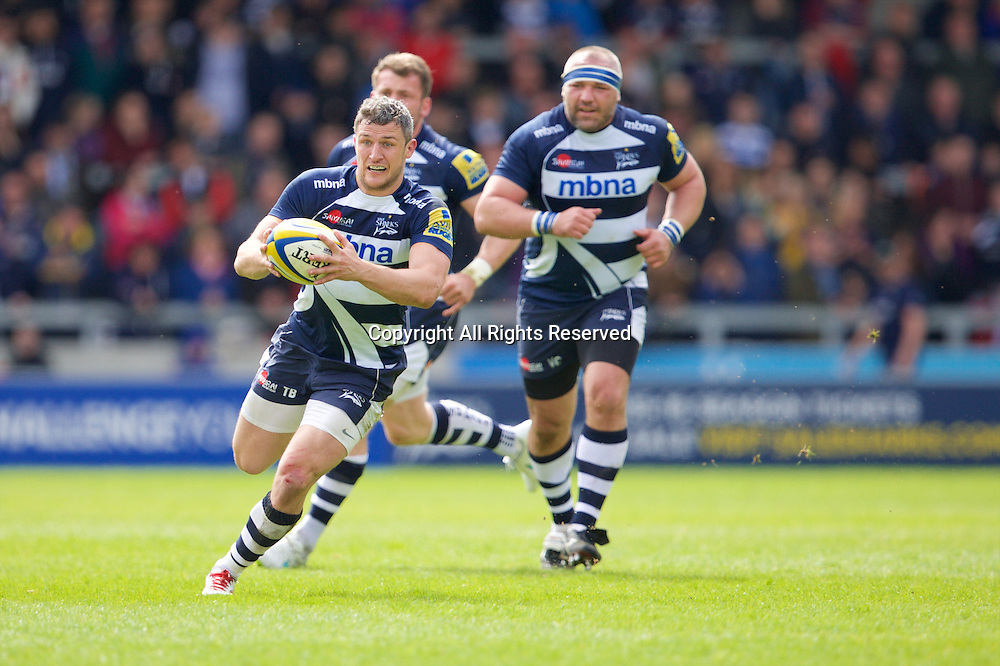 25.04.2015.  Sale, England.  Aviva Premiership Rugby. Sale Sharks versus Harlequins. Sale Sharks wing Tom Brady runs with the ball.