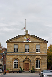 © Licensed to London News Pictures. 20/10/14. WOODSTOCK, OXFORDSHIRE, UK. Flag flies at half mast over Woodstock Town hall to make the death of the 11th Duke of Marlborough. Photo credit : MARK HEMSWORTH/LNP