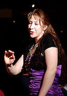 """Jene Rebbin Shaw (standing) during Mayhem & Mystery's production of """"Tragedy in the Theater"""" at the Spaghetti Warehouse in downtown Dayton, Monday, February 28, 2011."""