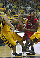 January 27, 2010: Ohio State guard/forward David Lighty (23) tries to drive between Iowa forward Aaron Fuller (24) and Iowa forward Jarryd Cole (50) during the first half of their game at Carver-Hawkeye Arena in Iowa City, Iowa on January 27, 2010. Ohio State defeated Iowa 65-57.